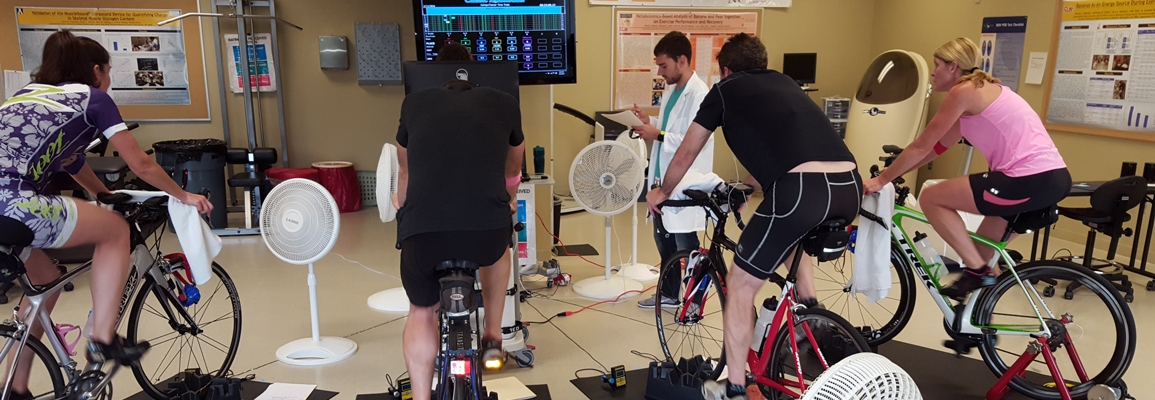 Working with athletes on stationary bikes in the lab