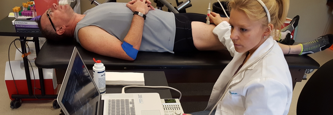 Student working with an athlete during testing